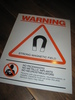 Stor plakat med tekst: WARNING.  STRONG MAGNETIC FIELD. Ca 31*41 cm stor.